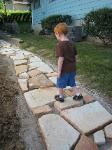 Pondering the path ahead of him...his new flagstone path, that is.