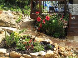 back yard oasis flagstone path and stone planters