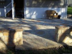 flagstone stepper patio - thin veneer over concrete - wall with brick trim