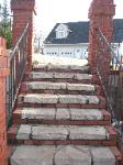 natural stone step with red brick trim