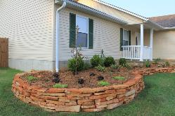 curving natural stone planting bed