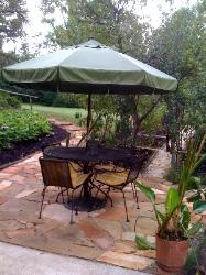 flagstone patio with table and umbrella
