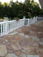 white balcony railing and natural stone patio in columbia, MO