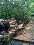 patio edge fish pond and waterfall