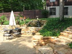 pool courtyard natural stone wall, steps and waterfall pond