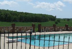 poolside natural ozark stone wall with red brick accents
