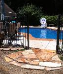 natural stone landing at pool gate