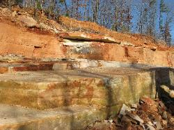 Sandstone is laid down horizontally in layers of varying thickness.