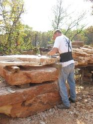 Splitting your sandstone takes patience and a good knowledge of the stone being worked. Usually a seam will have to be struck using a 12 pound sledge and a 4 pound splitter (wedge-headed hammer).