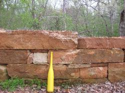 thick retaining wall slabs and boulders