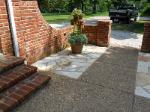 white sandstone pavers with aggregate and brick accent